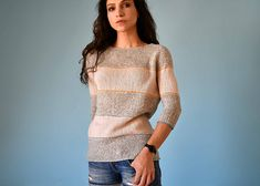 This Jumper with wide textured stripes and narrow accent colouring features a relaxed shaping at the body, narrow ¾ sleeves and low-cut armholes.