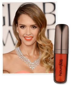 "Bright Lips Tips Straight from Celebrity Makeup Artists: Makeup artist Lauren Andersen took inspiration from Jessica Alba's peach-tinted Oscar de la Renta gown for her radiant beauty look. ""I loved the contrast between her glowing skin and the matte orange lip,"" Andersen said. Andersen used Hourglass' Opaque Rouge Liquid Lipstick in Riviera to achieve the look."