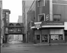 Old Trio Drugs downtown Flint Mi.  Kearsley St looking north down Brush Alley.