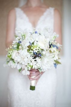 White and blue bouquet by beco flowers.    peonies, garden roses, grape muscari, sweet peas, mock orange, assorted grasses, succulents, passion flower vine (with blooms!!), ranunculus, lily of the valley, bouvardia, hydrangea, blackberry privet, maidenhair fern, clematis blossoms, nigella, blooming white summer clematis (small star shaped blossoms like our fall clematis