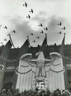 A very seldomly viewed yet brilliantly shot photograph of a great, metal imperial eagle under large, blood red swastika banners as the Luftwaffe fly in formation overhead. Luftwaffe, German Soldier, German Army, Ww2 History, World History, Military Art, Military History, Nazi Propaganda, Berlin
