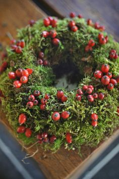 Jolly Holiday Candle Centerpiece - DIY - Berries in a foggy mossy forest - Add dry ice & berries, greenery (ferns, mosses, leaves…), branches, and flowers.