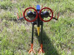 Bird Metal Sculpture Yard Bird Shovel Bird Yard Art Garden Art Painted Metal Bird Found Objects. $134.99, via Etsy.