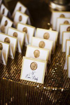 Elegant gold escort cards