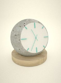 "Clock by Jason Lloyd Fletcher: Part of the ""Lua"" collection. Crafted with wood & hand-cast concrete / http://www.jasonlloydfletcher.com/Lua-2012"