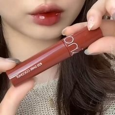 Get this spicy reddish-brown tone gloss to boost your summer look effortlessly! This lipstick from Romand Juicy Lasting Tint in shade Dark Coconut 20 is about 10$ on YesStyle. Super affordable and worth the hype😍 - Get money off using my code BLUSH13 + EGG21 Click the link now! #kbeauty #koreanlipstick #romand #juicylastingliptint #liptint #koreanbeauty #kbeautymakeup #makeuplooks #makeupideas #ulzzanglipstick #lipstick #kbeautyjunkie #lipstickdupes #affordablemakeup #discountcodes #blush Tint Lipstick, Brown Lipstick, Lipstick Dupes, Makeup Dupes, Makeup Kit, Makeup Inspo, Makeup Inspiration, Beauty Makeup, Korean Lipstick