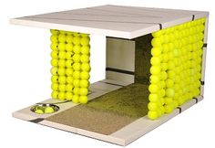 I like the idea of using tennis balls to lure the dogs out of the big house and into their own house.