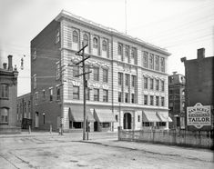 """1906. """"Columbus Institute, Poughkeepsie, N.Y."""" With a tailor, cycle shop, dentist and chewing gum close at hand.  8x10 inch glass negative, Detroit Publishing Company."""