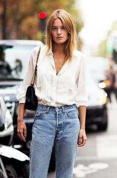 #denim #streetstyle camille rowe wearing an effortless yet classic outfit - high waist jeans and a loose silk shirt - perfect french style