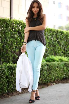 Mint jeans and a black top. Simple and stylish.