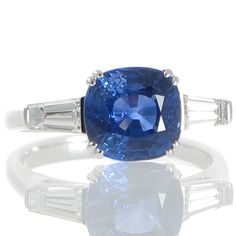 A 3.59ct Cushion Cut Sapphire Ring. View our collection of antique, Art Deco, and modern jewellery at www.rutherford.com.au