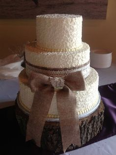 Burlap and lace wrapped wedding cake over lacy detail.