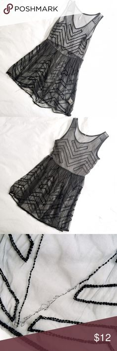 Free People Beaded Slip Dress ❗️This is a damaged piece of clothing!❗️ Sheer mesh slip by Free People in grey. There is beading missing throughout, although it's an easy fix with the right beads! I unfortunately don't have the extra bead pack. Sold as is, this is my lowest. NO TRADES. Size XS. Free People Dresses Mini