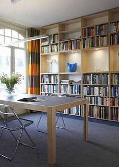 Simple floor to ceiling bookshelves with display space in the middle.