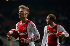 Viktor Fischer Photos Photos - Viktor Fischer (L) of Ajax gets ready to give a ball to the fans after victory in the Eredivisie match between Ajax Amsterdam and PSV Eindhoven at Amsterdam Arena on December 1, 2012 in Amsterdam, Netherlands. - Ajax Amsterdam v PSV Eindhoven - Eredivisie