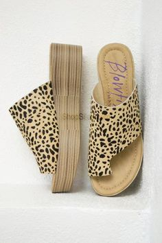 Add a little love to your feet with these super comfortable slip on mules! These slip ons features faux stack, lightly-padded footbed, toe thong, an animal print suede cover, and a synthetic sole. Hee