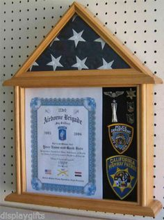 """All-in-one, Flag and Memorabilia display case holds the standard 3' x 5' service flag with attached display case to proudly display all your treasured awards and memorabilia. The display case has a glass front. Easy access from the back. You can put it on a table or hang it on the wall. Velcro-friendly backing for easy mounting of memorabilia. Foam under the backing felt for pins to push in. The bottom box measures 11""""H X 12.4""""W. No assembly required."""