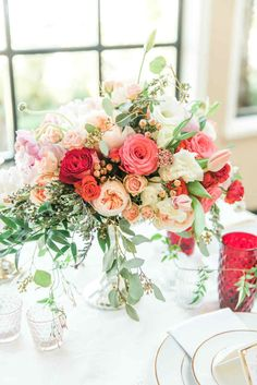 Pink, Coral, Peach and Red Wedding Flower Centrepieces