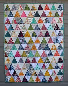 It seems fitting to finish this quilt in time for spring. (Well, technically it is spring, although we're expecting a bit of snow tomor. Boy Quilts, Scrappy Quilts, Antique Quilts, Vintage Quilts, Triangle Quilt Pattern, Triangle Quilts, Handmade Quilts For Sale, Quilt Of Valor, Thing 1