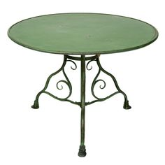 French Fabulous Green Iron Table; curved tripod base leading down to three hooved feet. Originally designed for the Luxemborg Gardens; 20th Century