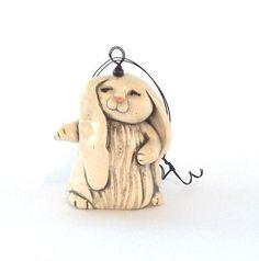 Rabbit Christmas Ornament Handmade Figurine. $18.00, via Etsy.