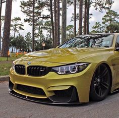 BMW F82 M4 yellow slammed