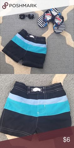 Boy's 6 month swimming trunks Very good condition. There is no size inside, but tag says 12.5 lbs - 18 lbs. They were bought at Target. These fit my son around 6 months. **Comes from a smoke-free and pet-free home. Check out my closet for other boy and girl clothing items size newborn through 3T..bundle to save!! Open to offers! Please let me know if you have any questions. Happy Poshing!! :) Swim Swim Trunks
