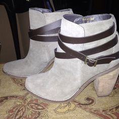 Dolce Vita booties Taupe/tan booties.  Great condition although in pic 3 it does ahi a small mark but really isn't visible to the eye when worn.  Worn two times. Dolce Vita Shoes Ankle Boots & Booties