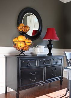 Good tutorial on getting the Pottery Barn black finish... and she found this dresser at a Goodwill store for...TWELVE BUCKS