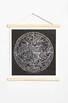Constellation Hanging Dowel Print | $45 Cosmic canvas wall art mounted onto a wooden frame and finished with an attached hang-cord for no-fuss placement. Instantly adds a charming touch to any space!