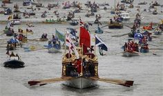 The Gloriana leads the manpowered craft towards Westminster Bridge during Queen Elizabeth's Diamond Jubilee Pageant on the River Thames in London