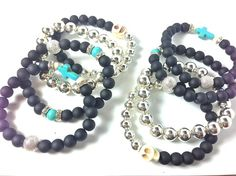 Hand made bracelet stack with gemstones on a sturdy stretch cord. Made from turquoise Howlite,crystal,sterling silver,silver stardust  and matt black beads. Featuring a Howlite skull and cross charm.    Bracelet fits most standard size wrists 6 -7.5 inches. If you think you may need a larger size...