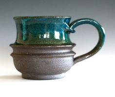 Sai L. - I really like this mug it has a unique shape as well as an elegant handle. It looks really simple yet it looks really elegant. I would love to do this mug because the colors, the shape, the handle, and the ridges speak of simplicity, yet the mug also stands as an elegant piece.