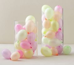 Fill empty glass vases with mini balloons as a quick, easy pick-me-up for a plain party table.