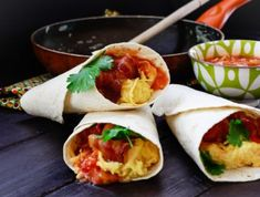 Wrapped up bacon, cheese, Mexican-style tomato mix and coriander into a delicious tortilla. Simply double up the recipe if you've got a crowd coming over. Beans On Toast, Breakfast Wraps, Mexican Style, Coriander, Cheddar Cheese, Fresh Rolls, Spice Things Up, Spicy, Bacon