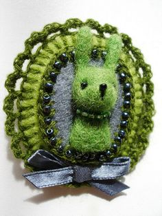Green Portrait: Needle Felted and Crocheted Brooch by Agne Vasiukeviciute