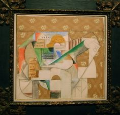 Pablo PIcasso, Guitar and Sheet Music, 1912. (Cut and pasted papers, pastel, and charcoal on paper, 22 1/2 x 24 inches. Pictured framed in private collection. Click for further detail).
