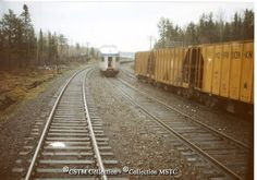 Franz, ON  Railway Name:   VIA RAIL CANADA INC.  Date:   1983-00-00  Caption:   The two Canadians have just crossed. Morrison Knudsen cars on siding construction co.