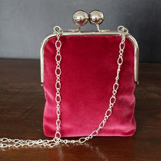 Beautiful purse in wine red velvet with silver kisslock frame and detachable chain Perfect as an evening bag or for a wedding or party The frame has