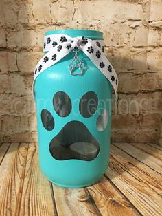 Paw print painted mason jar tea light candle holder. 7 inches tall 32 oz painted mason jar. (quart size) Color in photos is black, turquoise, beige and blue. We have a variety of colors to choose from. Pick your color from drop down menu at checkout. Please note actual color may