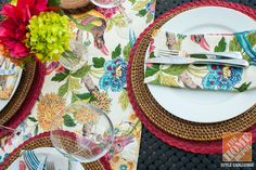 Colorful table linens give an outdoor dining room a fun burst of color! We love how Kelly layered patterned linens with woven placemats!