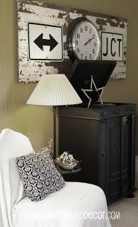 an old plank door serves to make two old traffic signs and a broken clock into wall art. from homewardfounddecor.com