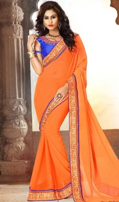 If you are on a fashion hunt for the perfect attire for your special occasions, look no further! get this orange color shade chiffon sari. This engaging saree is displaying some great embroidery done with lace, resham and stones work. #chiffonsarees #orangecolorsaris #sarionline #womensaree
