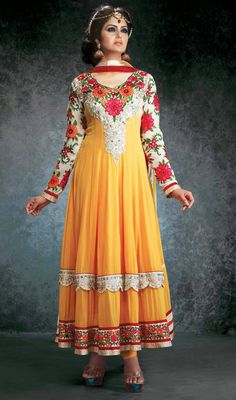 Yellow Georgette Layered Long Anarkali Suit Induce peaceful and refreshing vibes with this yellow georgette layered long Anarkali suit. Beautified with lace, resham and stones work.  #LongAnarkaliSuit #LatestChuridarSuits