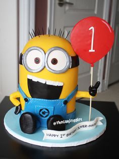 Cute 3D Sculpted Minion Cake for a first birthday. Gumpaste/Fondant www.thecakinggirl.ca