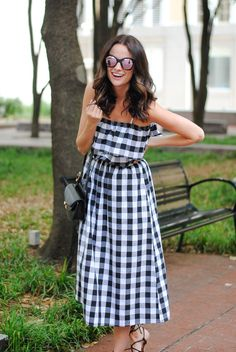 Amanda Miller wearing pink mirrored sunglasses and a off the shoulder gingham dress