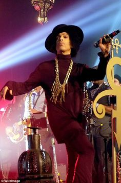 Prince performs onstage at The Hollywood Palladium on March 8, 2014 in Los Angeles