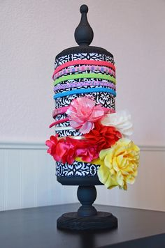 Oatmeal container + wood pieces & fabric! Cute headband holder!