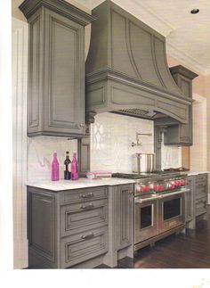gorgeous grey cabinets not quite enough for ya... how bout we throw in pink knobs too?!