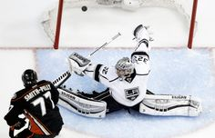 Devante Smith-Pelly of the Anaheim Ducks (left) scores past Los Angeles Kings' goalie Jonathan Quick during the second period in Game 5 of an NHL hockey second-round Stanley Cup playoff series in Anaheim, Calif.